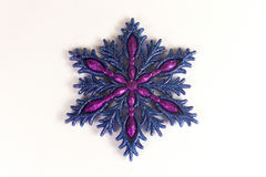 Blue snowflake with glitter. On the white background Stock Images