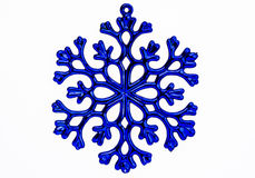 Blue snowflake ornament isolated on a white background. Royalty Free Stock Photos