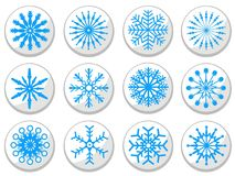 Blue snowflake round buttons set. Isolated blue snowflake round buttons set on white background Stock Photo