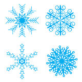 Blue Snowflakes. 4 snowflake designs in blue, There is also an .eps file available Stock Photos