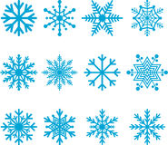 Blue snowflakes. Collection or set of blue on white snowflakes in a variety of shapes and patterns Stock Photos