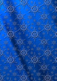 Blue snowflakes on a dark blue wavy gradient background Stock Photos