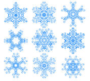 Blue snowflakes over white. Royalty Free Stock Photo