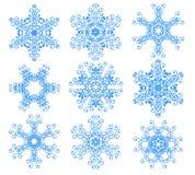 Blue snowflakes over white. Nine fancy blue snowflakes over white for background Royalty Free Stock Photo