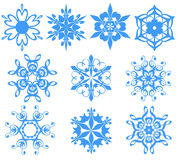 Blue snowflakes over white. Ten fancy blue snowflakes over white for background Royalty Free Stock Photography