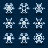 Blue snowflakes. Blue snowflakes and shadow on dark background Royalty Free Stock Photos