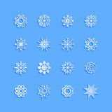 Blue snowflakes and shadow on white background. Stock Photo