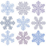 Blue snowflakes on a white background Royalty Free Stock Images