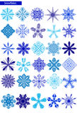 Blue snowflakes on a white background Stock Images