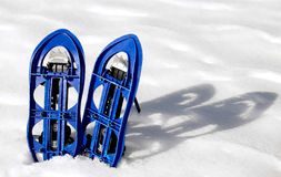 Blue SNOWSHOES for excursions on the snow Royalty Free Stock Photo