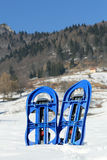Blue SNOWSHOES for excursions on the snow Stock Photo