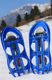 BLUE snowshoes in the mountain Stock Images