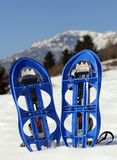 Blue snowshoes in the mountain Stock Photography