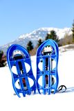 Blue snowshoes in the mountain Royalty Free Stock Image