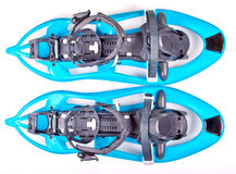Blue Snowshoes. Partly isolated on white background royalty free stock photo