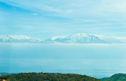Blue snowy mountains and Ohrid lake in Macedonia Stock Images