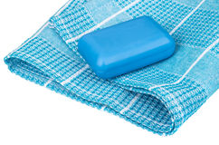 Blue soap on checkered towel isolated on white. Background Royalty Free Stock Photos