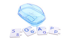 Blue soap-dish and puzzle pieces Stock Image