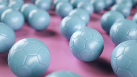 Blue soccer balls on pink surface. Picture of a blue leather soccer balls on pink surface. 3D Render Royalty Free Stock Image
