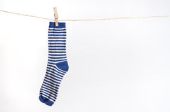 Blue sock. Hanging on withe background Royalty Free Stock Images