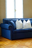 Blue sofa angle 2 Royalty Free Stock Images