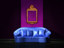 Blue sofa with antique frame on the wall. In minimalist interior Royalty Free Stock Photos