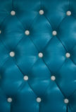 Blue sofa background Stock Images