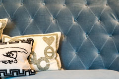 Blue Sofa & Cushions. Blue Studded Sofa with Patterned Cushions Royalty Free Stock Photo