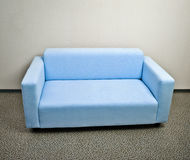 Blue sofa furniture Stock Photo