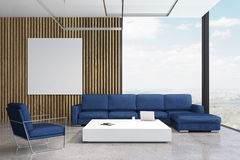 Blue sofa living room with poster Stock Image