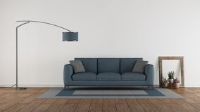 Blue sofa in a minimalist living room royalty free stock image