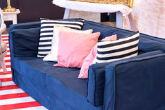 Blue sofa with nobody in studio interior decoration. Selective focus Royalty Free Stock Photo