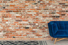 Blue sofa and pattern rug Stock Photos