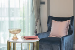 blue sofa with pink pillow and round table in living room Stock Photo