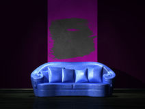Blue sofa with purple part of the wall Stock Photos