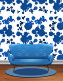 Blue sofa in room with blue splash wallpaper Stock Photo