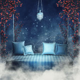 Blue sofa and rose vines Stock Images
