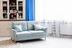 Blue sofa in white modern interior with Christmas decorations. stock images
