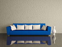 Blue sofa with white pillows Stock Images