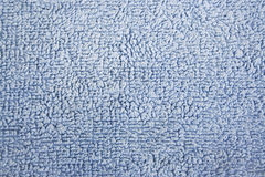 Blue soft cotton bath towel texture Stock Photography
