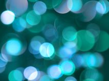 Blue soft glowing round blurred lights decorative abstract background royalty free stock photos