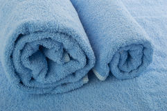 Blue soft towel. Two rolled towels/texture of fabrics Stock Image