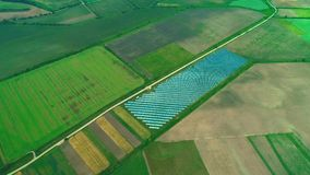 Aerial drone view of the large solar farm in the green fields. Zoom. 4K. stock footage