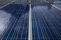 Blue solar cell panels that shown its surface grid line and textures. The panels are against sun light on noon time have shadow re. Flex on it look like high Stock Image