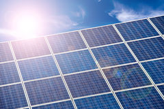 Blue solar cells, blue sky and sun. Halo Royalty Free Stock Images