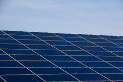 Blue solar panels. Angled blue solar panels with sky background Royalty Free Stock Photography