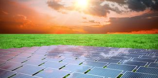 Composite image of blue solar panels. Blue solar panels against grass stock illustration