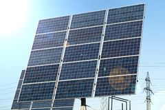 Blue solar panels against the sun royalty free stock photography