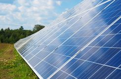Blue solar panels. Blue solar panels in the field. Renewable energy Royalty Free Stock Photos