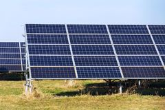 Blue solar panels photovoltaics power station, future innovation energy concept. Blue solar panels in photovoltaics power station farm, future innovation energy Stock Images